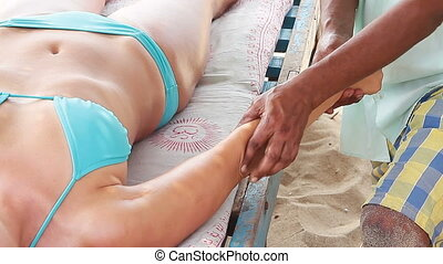 Close up of therapist's hands doing arms massage on woman