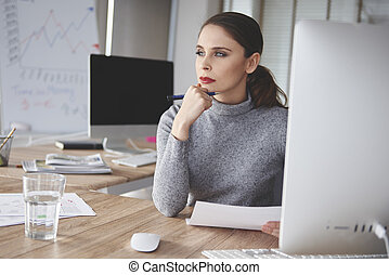 Close up of thoughtful young business woman