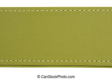 thread seam on green leather - Close-up of thread seam on...