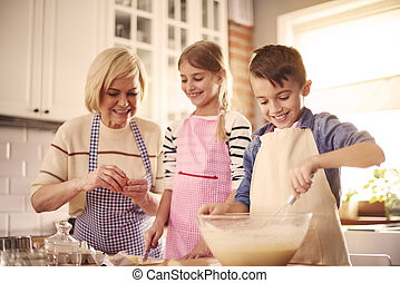 Close up of three chefs in the kitchen