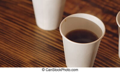 Close up of three cups of delicious coffee on the wooden table