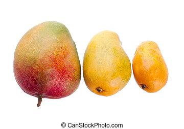 close up of three mangoes