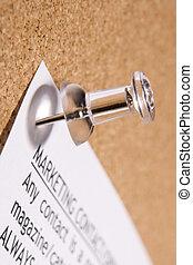 Close Up Of Thumbtack In Bulletin Board