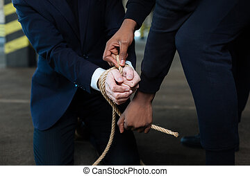 Close up of tied hands