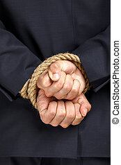 Close up of tied hands of businessman