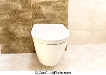 Close up of toilet bathroom interior with white ceramic seat