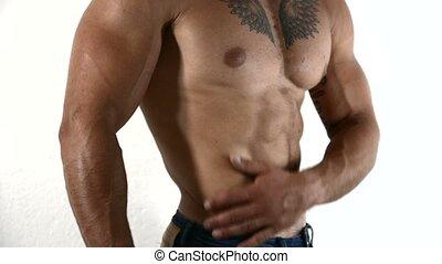 Close-up of topless muscular man