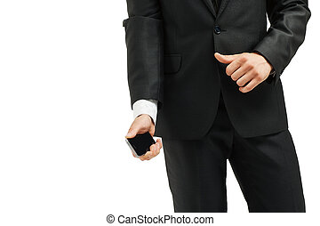 close-up of torso  man in suit and tie  modern smartphone in hand. on the left side  the photo is blank for your text