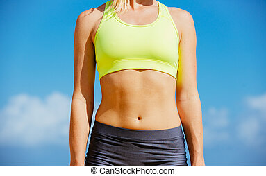 Close-up of torso of fitness woman