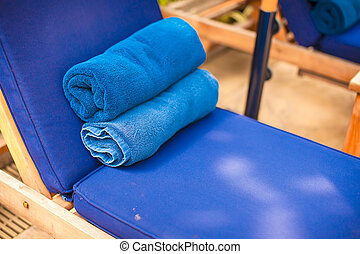 Close-up of towels near luxury swimming pool at tropical resort