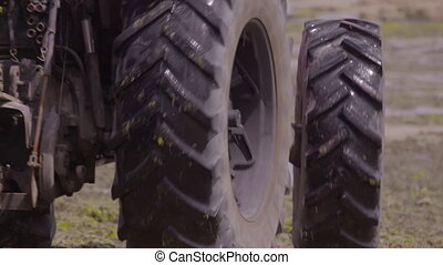 Close up of tractor hauling supplies on a beach - Close up ...