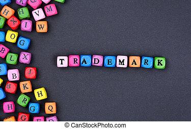 Trademark word on black background