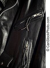 close up of traditional black classic leather biker jacket
