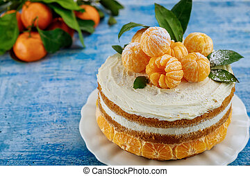 Close up of traditional christmas naked cake with fresh mandarins.