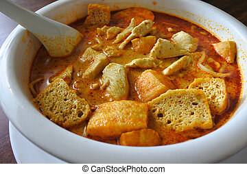 Close up of traditional Malaysian curry laksa dish served in...