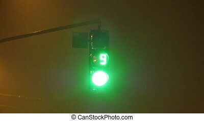 Close-up of traffic lights with timer from green to red at night