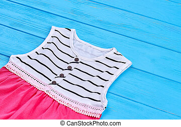 Close up of trendy baby-girl summer outfit.