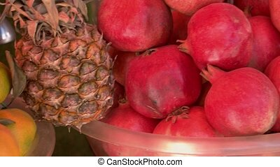 Close up of tropical fruits at market stall. Stall with fresh exotic fruits at food market.