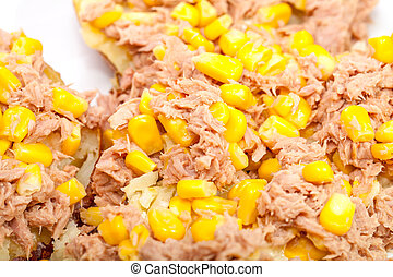 Close up of tuna and sweetcorn on baked potato.