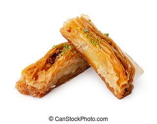 Close up photo of Turkish dessert baklava isolated on white
