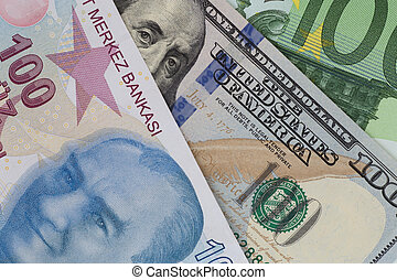 close up of turkish lira, dollar and euro banknotes