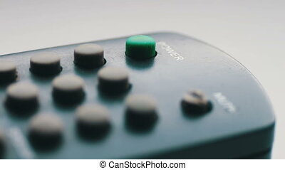 Close up Of TV Remote - TV remote control, the finger...