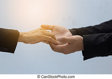 close up of two business woman holding hands. care and support concept