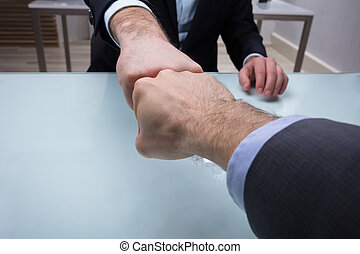 Two Businessmen Making Fist Bump