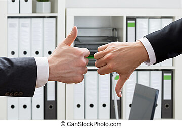 Businesspeople Hands Showing Thumb Up And Thumb Down