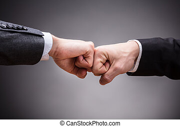 Two Businesspeople Making Fist Bump