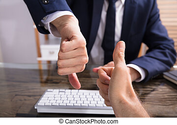 Two Businesspeople Showing Thumb Up And Thumb Down Sign