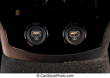 Close up of two car interior usb charging cable connection