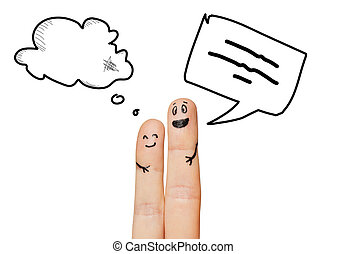 close up of two fingers with communication clouds -...