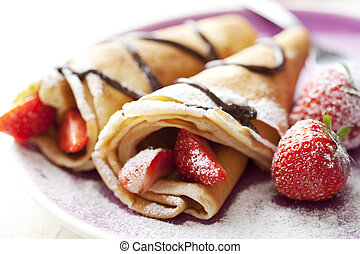 crepes - close up of two french style crepes, shallow dof. ...