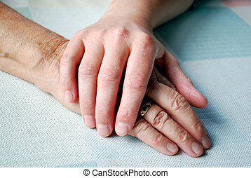 close-up of two hands on the table with daylight.