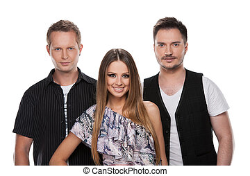 Close up of two handsome men and beautiful woman at the middle. Standing together isolated over white background