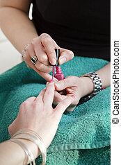 close up of two women applying nail varnish