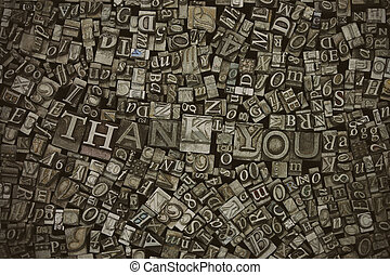 Close up of typeset letters with the words Thank You - Close...