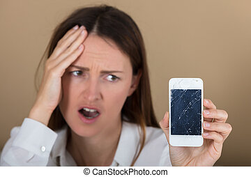 Unhappy Woman Holding Smart Phone