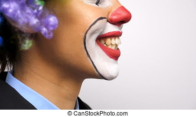Close up of unrecognisable clown smiling large to the camera...