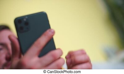 Close-up of using a new smartphone in hands.