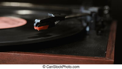 Close-up of using an antiquarian vinyl record player....