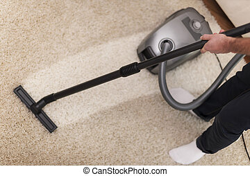Close up of vacuuming a carpet