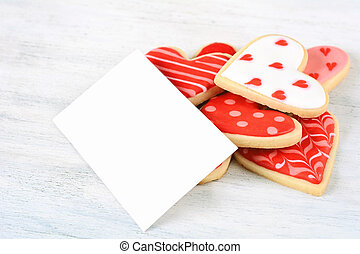 Close up of Valentine's day cookies with empty greeting card