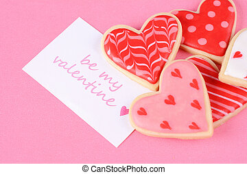 Close up of Valentine's day cookies with greeting card