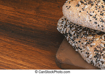 Close up of various types of bread on wooden background