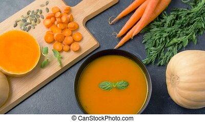 close up of vegetable pumpkin cream soup in bowl - food, new...