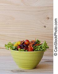Close up of Vegetable salad on wooden backgrounds vertical