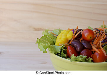 Close up of vegetable salad to eat on wooden backgrounds