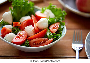 close up of vegetable salad with mozzarella